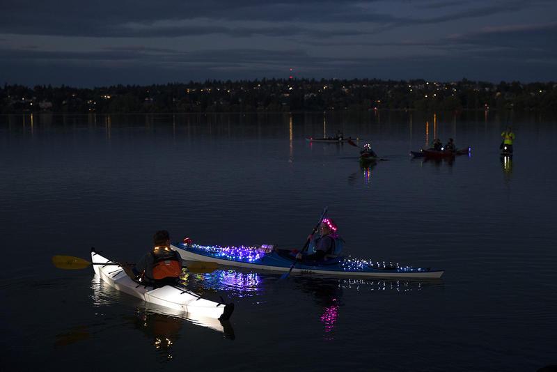Illuminated kayaks are shown during the Luminata lantern parade on Thursday, September 21, 2017, at Green Lake in Seattle.