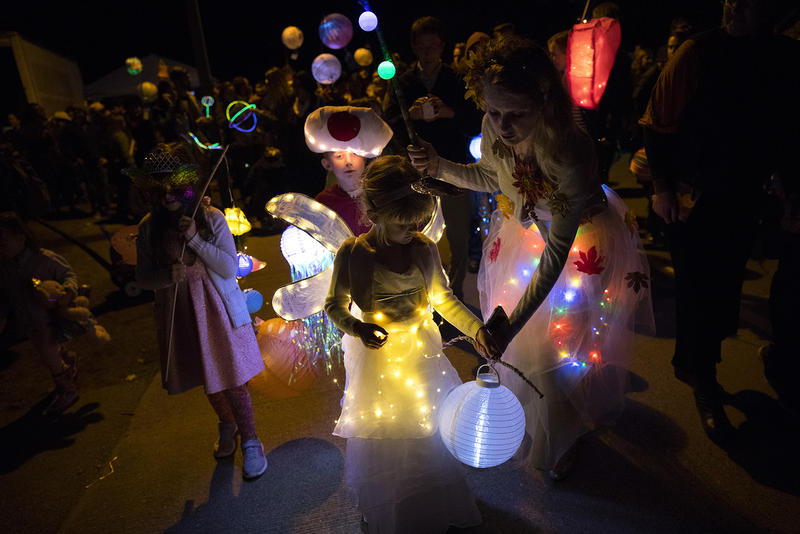 Parade goers march during the Luminata lantern parade on Thursday, September 21, 2017, at Green Lake in Seattle.