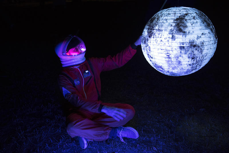 Zee McManus holds a moon lantern during the Luminata lantern parade on Thursday, September 21, 2017, at Green Lake in Seattle.