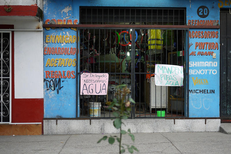Signs in stores south of Mexico City read 'we need water.'