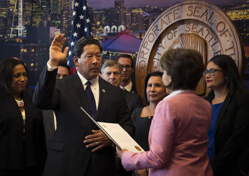 Seattle City Council President Bruce Harrell is sworn into office by city clerk Monica Simmons, right, becoming the mayor of Seattle, on Wednesday, September 13, 2017, at City Hall.