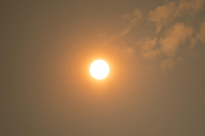 The sun is shown through the smoke from N. Northlake Way on Tuesday, September 5, 2017, in Seattle.