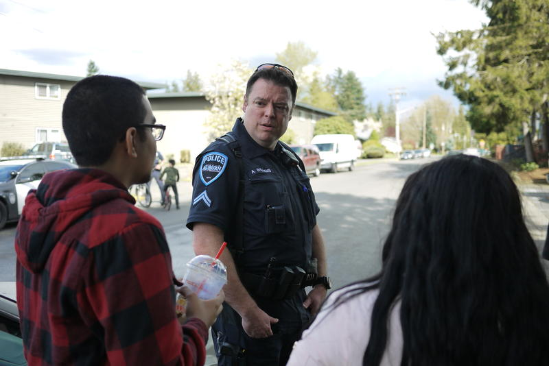 File photo. Auburn police talk to residents.