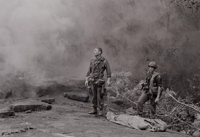 US Service Member, standing in smoke, shocked.