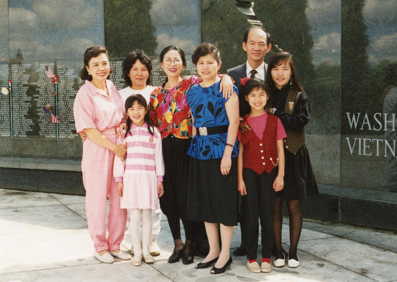 Thanh Tan (bottom row, right), her family and friends at the Washington State Vietnam Veterans Memorial in 1990.