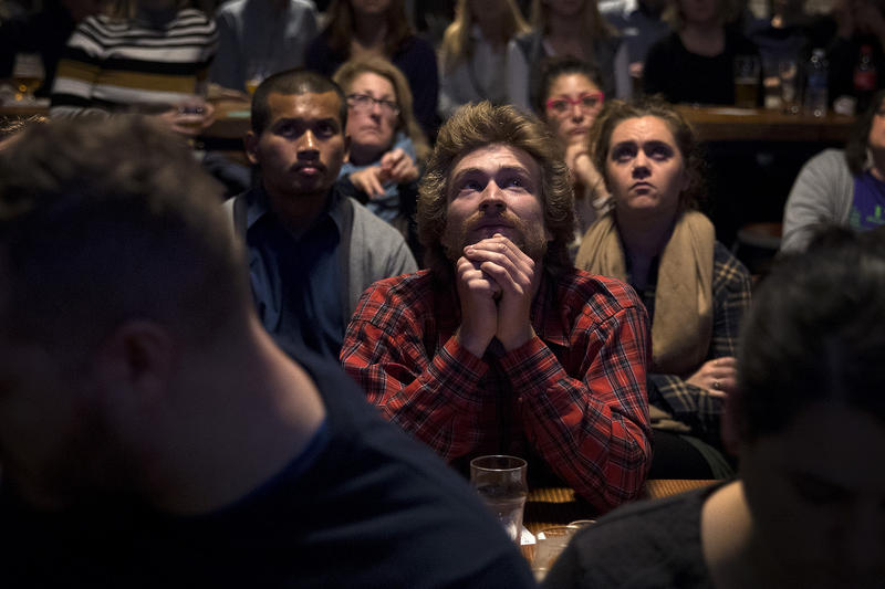 Jacob Mandell watches a mayoral debate during a viewing party on Tuesday, October 24, 2017, at Optimism Brewing Company in Seattle.