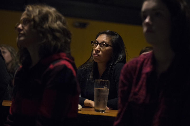 Lauren Ko watches during a mayoral debate viewing party on Tuesday, October 24, 2017, at Optimism Brewing Company in Seattle.