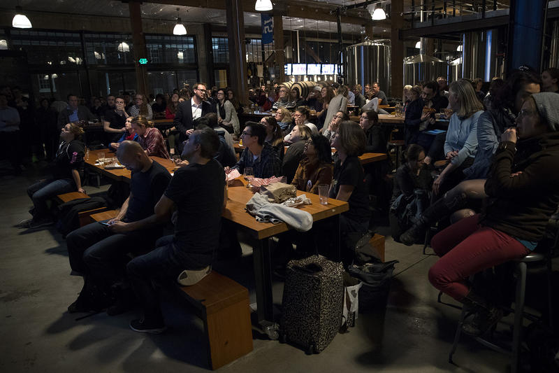 A crowd gathers during a mayoral debate viewing party on Tuesday, October 24, 2017, at Optimism Brewing Company in Seattle.