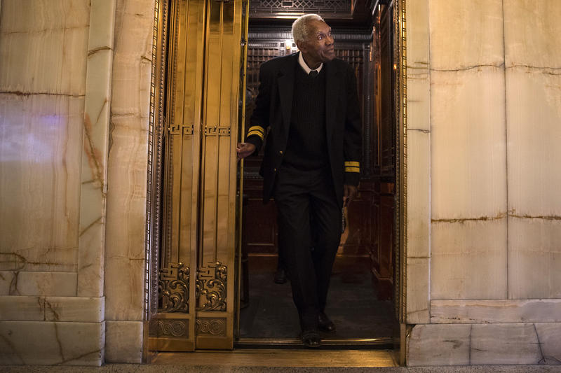 Hamilton Beale stands in the doorway of an elevator in the lobby of Smith Tower on Wednesday, October 18, 2017, in Seattle. Beale has been operating elevators at Smith Tower for 19 years.