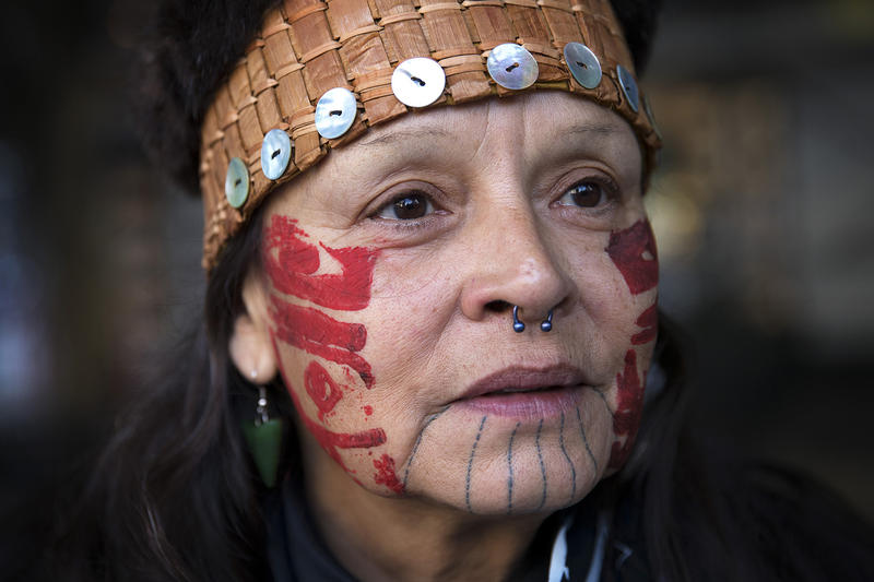 Frieda Eide, an Alaskan native of the Tlingit Tribe, stands as speeches are made before the Indigenous Peoples' Day march and celebration on Monday, October 9, 2017, at Westlake Park in Seattle. 'It means we're still here and I'm proud,' Eide said.