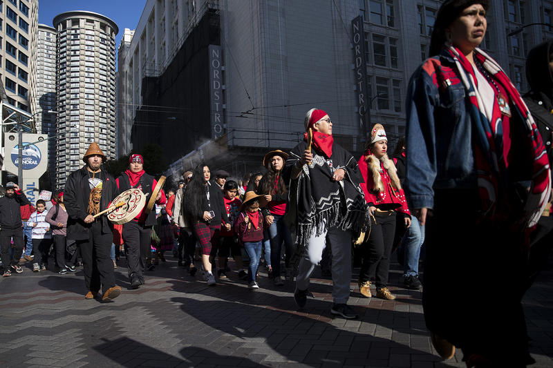 People march from Westlake Park to Seattle City Hall during the Indigenous Peoples' Day march and celebration on Monday, October 9, 2017, in Seattle.