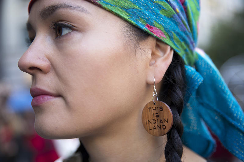 Marianna Harvey of Yakama Nation stands during the Indigenous Peoples' Day march and celebration on Monday, October 9, 2017, at Westlake Park in Seattle.