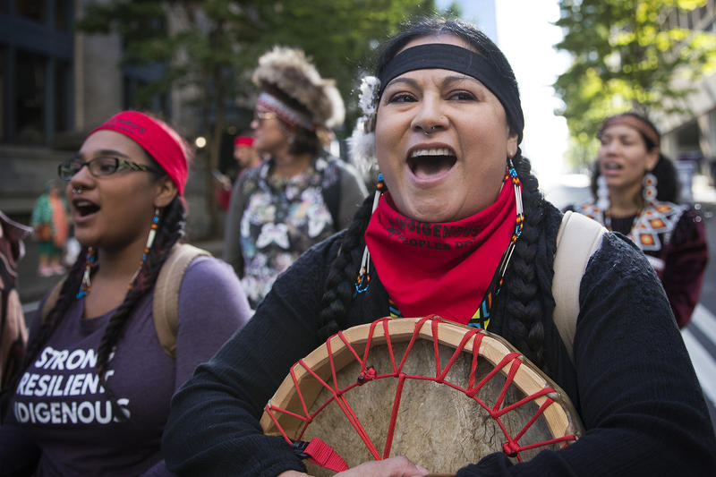 Jennifer Feuntes, of the Apache Tribe, sings during the Indigenous Peoples' Day march and celebration on Monday, October 9, 2017, in Seattle.