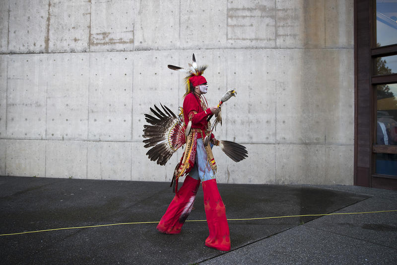 Nikk Dakota of the Turtle Mountain Chippewa Tribe walks into the Indigenous Peoples' Day Celebration at Daybreak Star Cultural Center on Monday, October 9, 2017, in Seattle.