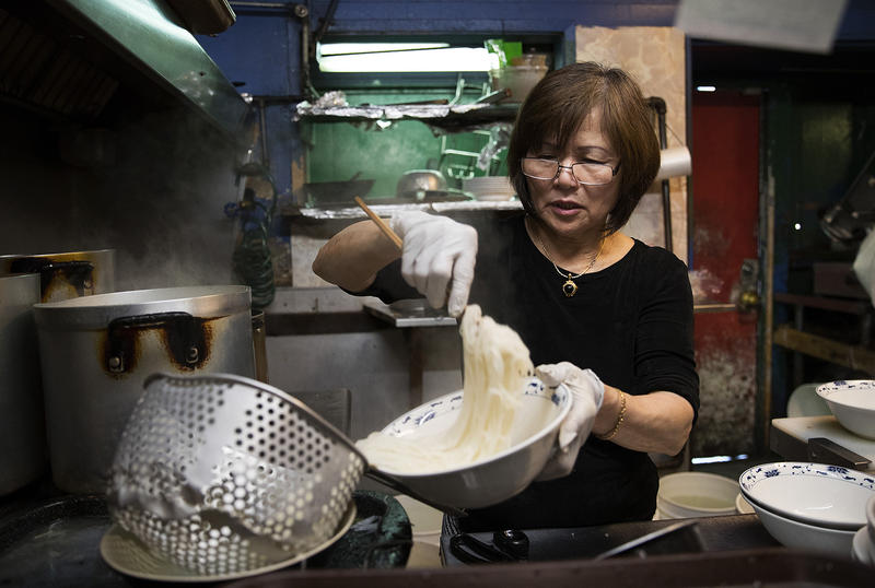 Minh Pham portions out noodles for customers on Tuesday, August 15, 2017, in the kitchen at Pho Bac on S. Jackson St., in Seattle.