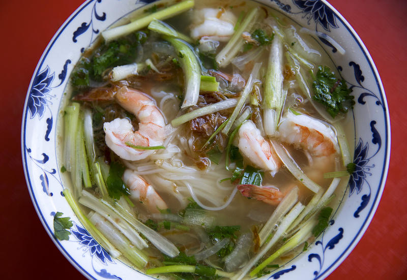 Pho with cilantro, onion, green onion, prawns, noodles, fried shallots and beef broth is shown on Tuesday, August 15, 2017, at Pho Bac on S. Jackson St., in Seattle.