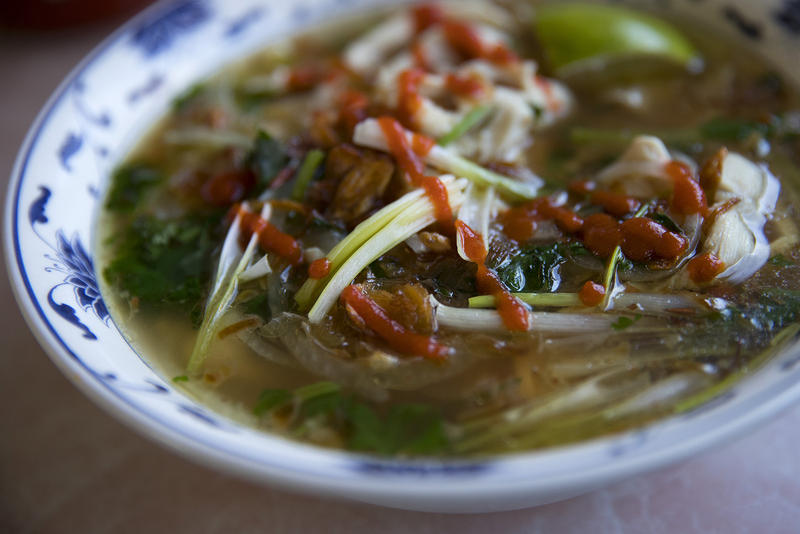 Pho with chicken, cilantro, onion, green onion, noodles, friend shallots, beef broth and sriracha sauce is shown on Tuesday, August 15, 2017, at Pho Bac on S. Jackson St., in Seattle. KUOW Photo/Megan Farmer