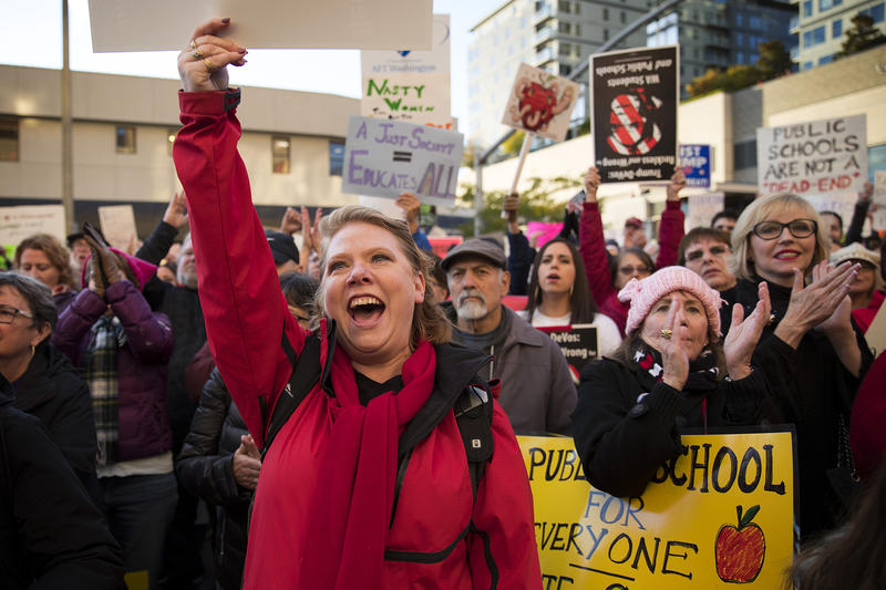 Veronica Cook of Shoreline cheers with other protesters outside of the Hyatt Regency where Secretary of Education Betsy DeVos was scheduled to speak at the Washington Policy Center's annual gala on Friday, October 13, 2017, in Bellevue.