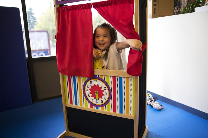 Isley Best, 4, puts on a puppet show on Sunday, October 1, 2017, at We Rock the Spectrum Kid's Gym in Bellevue.