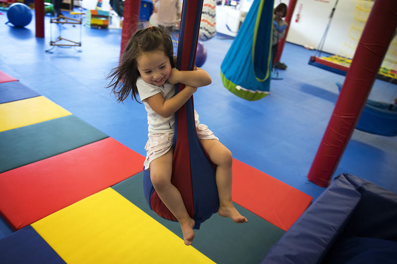 Isley Best, 4, rides a zipline on Sunday, October 1, 2017, at We Rock the Spectrum Kid's Gym in Bellevue.