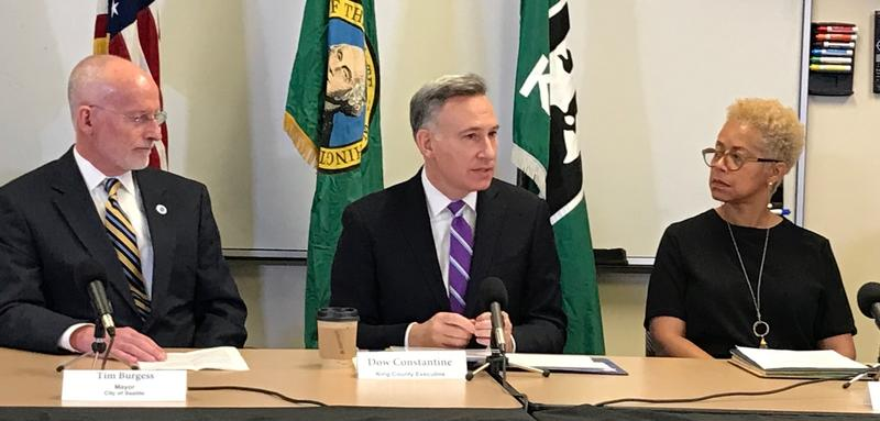 Former Seattle Mayor Tim Burgess, King County Executive Dow Constantine and Deputy Executive Rhonda Berry at a press conference announcing the intent to move youth detention oversight to Public Health Seattle King County.