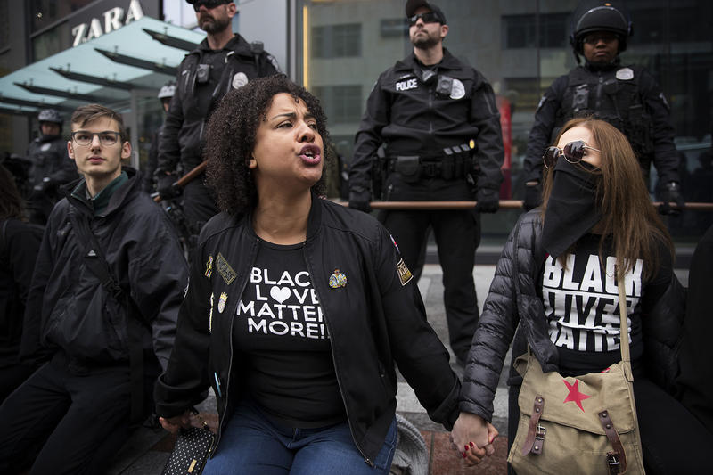 Protesters attempt to block the entrance of Westlake Center  on Friday, November 24, 2017, during a Black Lives Matter rally, in Seattle.