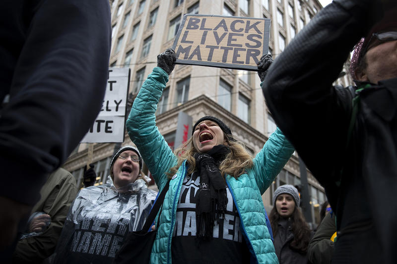 Melanie Forster chants during a Black Lives Matter rally on Friday, November 24, 2017, near Westlake Park in Seattle.
