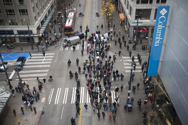 Protesters march through the intersection of 3rd and Pine Streets on Friday, November 24, 2017, during a Black Lives Matter rally in Seattle.