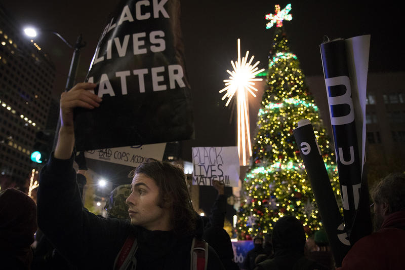 Cooper S., 21, protests during a Black Lives Matter rally on Friday, November 24, 2017, in front of Westlake Center in Seattle.