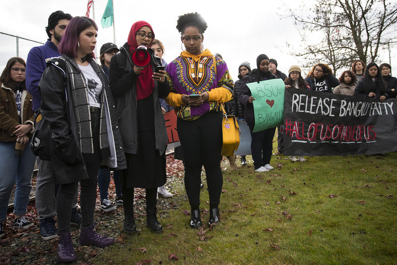 University of Washington students from left, Gema Soto-Marquez, Maryam Hussain and Naomi Rodriguez speak to a crowd before a bond hearing for Bengally Fatty on Wednesday, November 29, 2017, at the Northwest Detention Center in Tacoma.