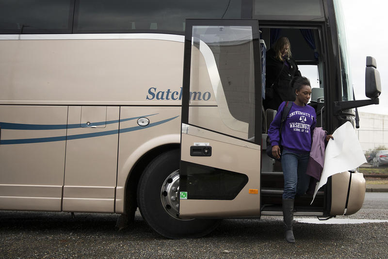 University of Washington law student Jabu Diagana walks off of a bus full of students and faculty on Wednesday, November 29, 2017, before a bond hearing for Bangally Fatty, at the Northwest Detention Center in Tacoma.