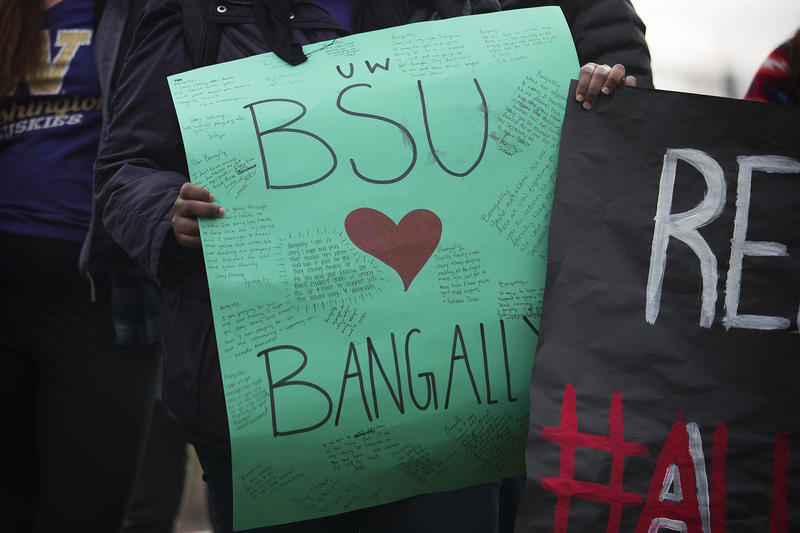 University of Washington student Mulki Mohamed holds a sign on Wednesday, November 29, 2017, before a bond hearing for Bangally Fatty at the Northwest Detention Center in Tacoma.