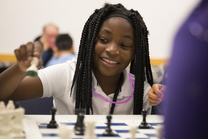: Brooklyn White, 8, plays a game of chess against Deeqo Abdullahi, 11, during Detective Cookie's Urban Youth Chess Club on Tuesday, November 28, 2017, at the Rainier Beach Library in Seattle.