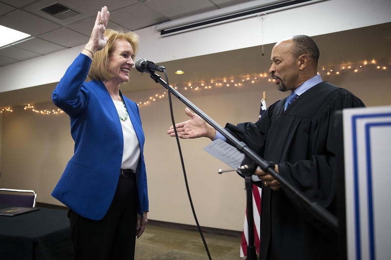 Seattle mayor Jenny Durkan takes the oath of office, administered by U.S. District Court Judge Richard Jones, right, on Tuesday, November 28, 2017, at the Ethiopian Community Center in Seattle.