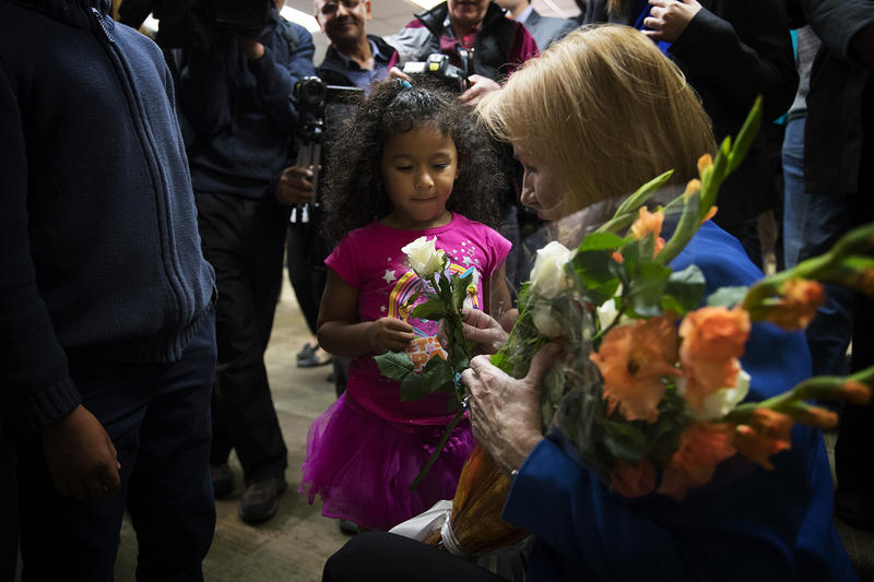 Seattle mayor Jenny Durkan gives a rose to 4-year-old Araceli Cotto, after taking the oath of office on Tuesday, November 28, 2017, at the Ethiopian Community Center in Seattle.