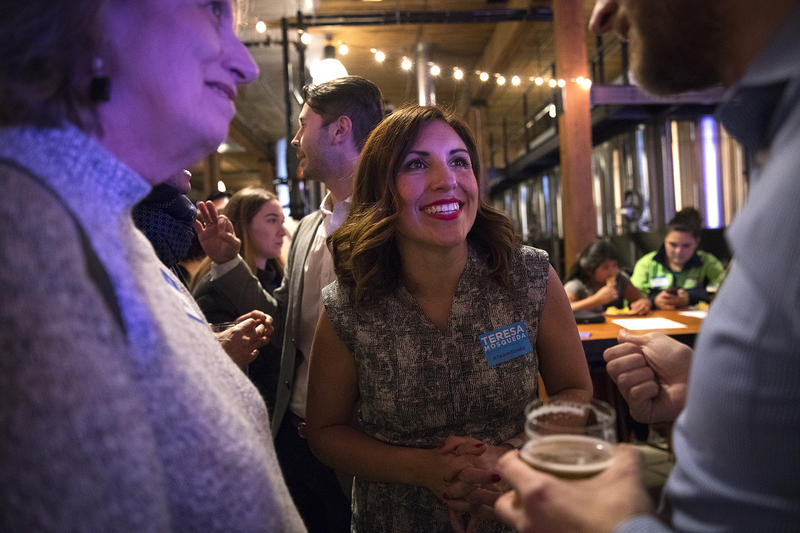Teresa Mosqueda greets supporters on Tuesday, November 7, 2017, at Optimism Brewing Company in Seattle.