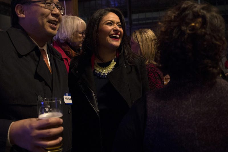 Lorena Gonzalez, center, laughs while greeting supporters on Tuesday, November 7, 2017, at Optimism Brewing Company in Seattle.