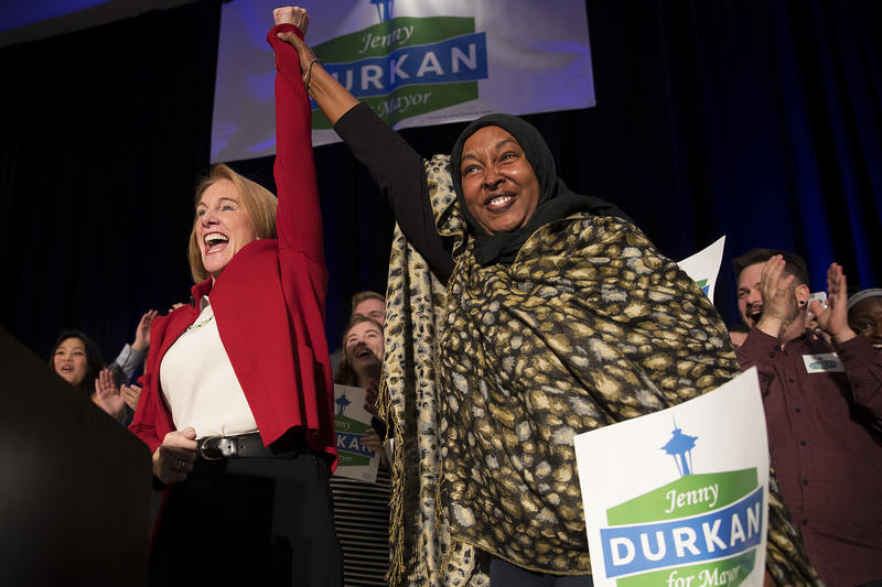 Jenny Durkan celebrates with family friend and volunteer Asha Mohamed on stage on Tuesday, November 7, 2017, at the Westin in Seattle.