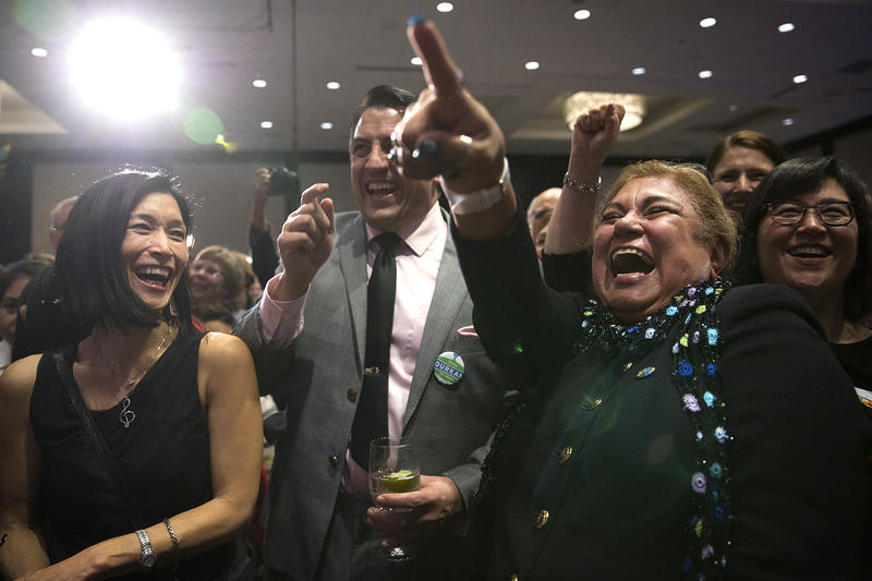 Rosa Melendez, right, points toward Jenny Durkan as she thanks her volunteers on Tuesday, November 7, 2017, at The Westin in Seattle.