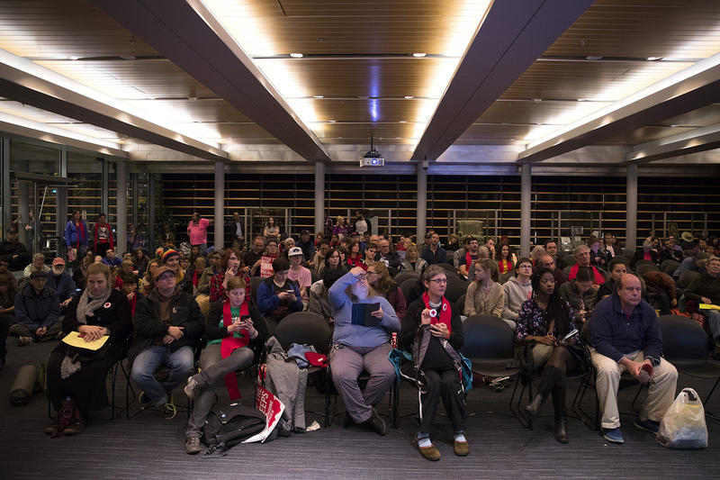 A crowd of people fills the over flow room during the public hearing on Wednesday, November 1, 2017, at City Hall in Seattle.
