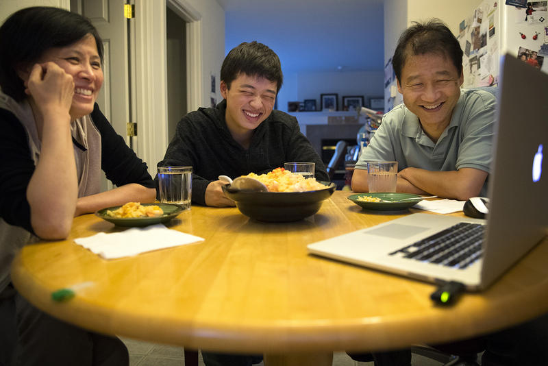 The author (middle) with his mother, Guoping Ma (left), and his father, Siyuan Liu. Here they Skype over dinner with family in Tianjin, China.