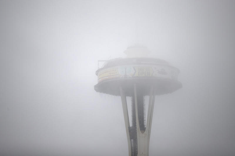 The space needle is shown through rain and fog  on Tuesday, November 21, 2017, in Seattle.