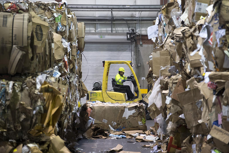 Bales of cardboard, left, and mixed paper, right, are shown on the loading dock at the Recology CleanScapes Materials Recovery Facility on Tuesday, October 31, 2017, on S. Idaho St., in Seattle.