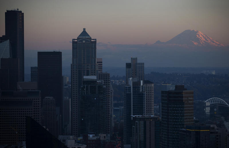 A view of Mount Rainier is shown from the suspended scaffolding below the new rotating restaurant at the Space Needle on Monday, November 6, 2017, in Seattle.