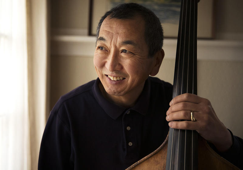 Marcus Tsutakawa, former orchestra director at Seattle's Garfield High School, poses for a portrait with his double bass on Tuesday, November 28, 2017. Marcus is the youngest of George and Ayame Tsutakawa's four children.