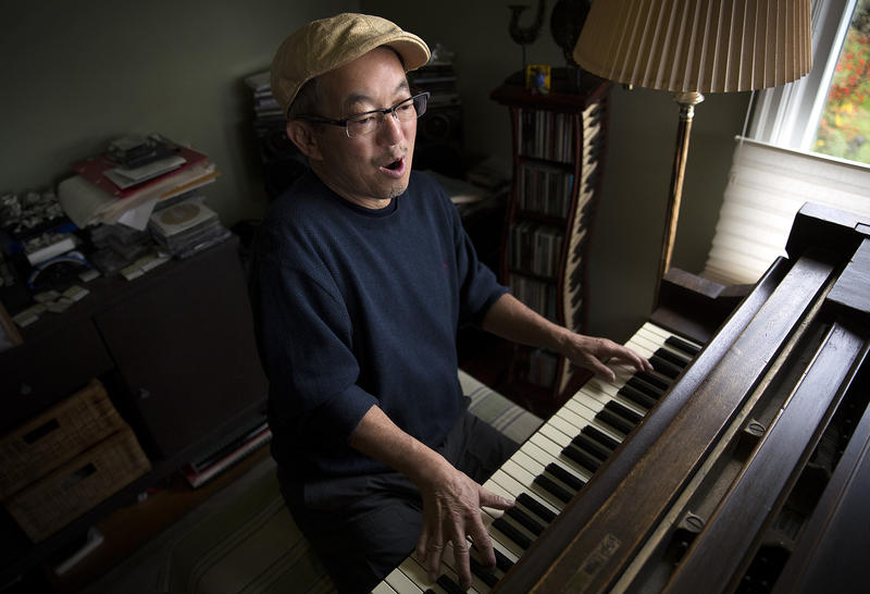 Deems Tsutakawa, the third of George and Ayame Tsutakawa's four children, plays his grand piano on Tuesday, November 28, 2017, at his home in Seattle.