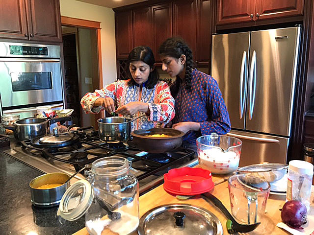 Neelima Musaliar (L) learned to cook as a prerequisite for an arranged marriage. Now she's teaching her daughter Aliyah (R) to cook to show her that she doesn't need to stir the pot for anyone other than herself.