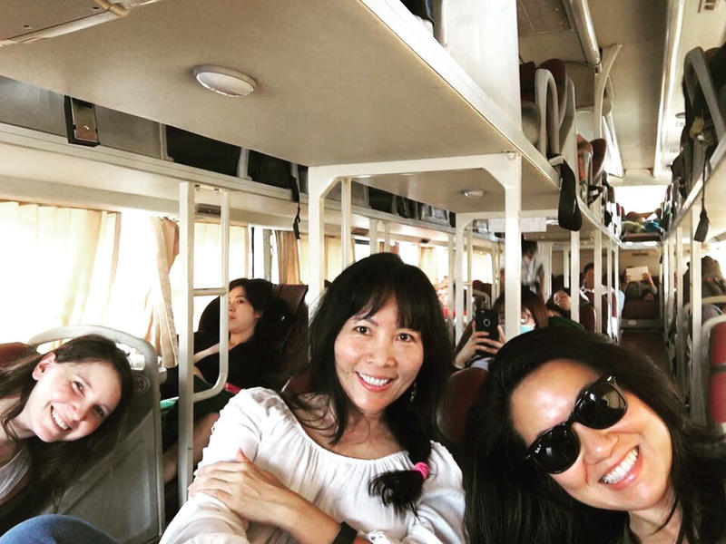 Caroline Chamberlain, Kristie Nguyen and Thanh Tan riding on a bus from Saigon to Ca Mau, Vietnam
