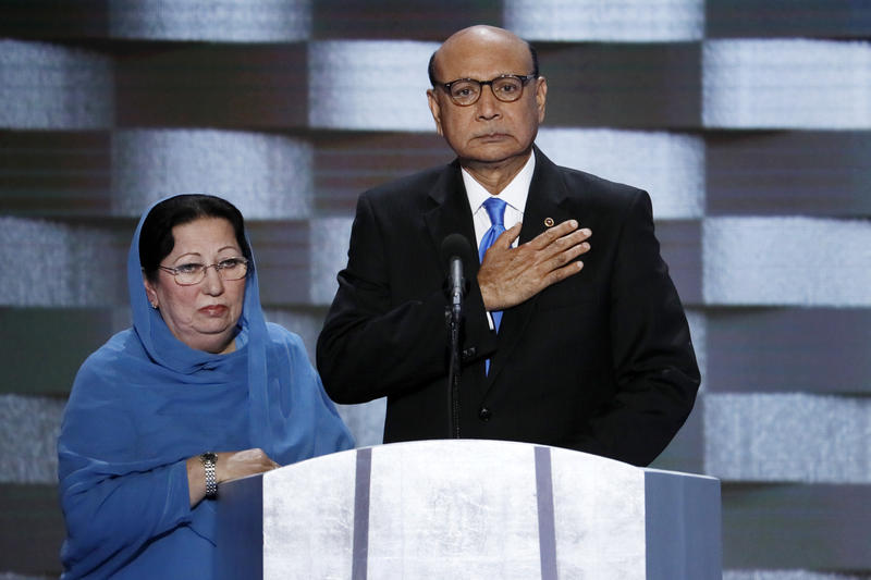 FILE - In this July 28, 2016, file photo, Khizr Khan, father of fallen Army Capt. Humayun Khan and his wife Ghazala speak during the final day of the Democratic National Convention in Philadelphia.