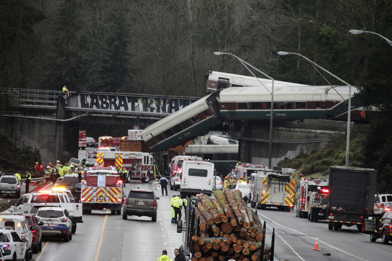 A derailed train is seen on southbound Interstate 5 on Monday, Dec. 18, 2017, in DuPont, Wash.